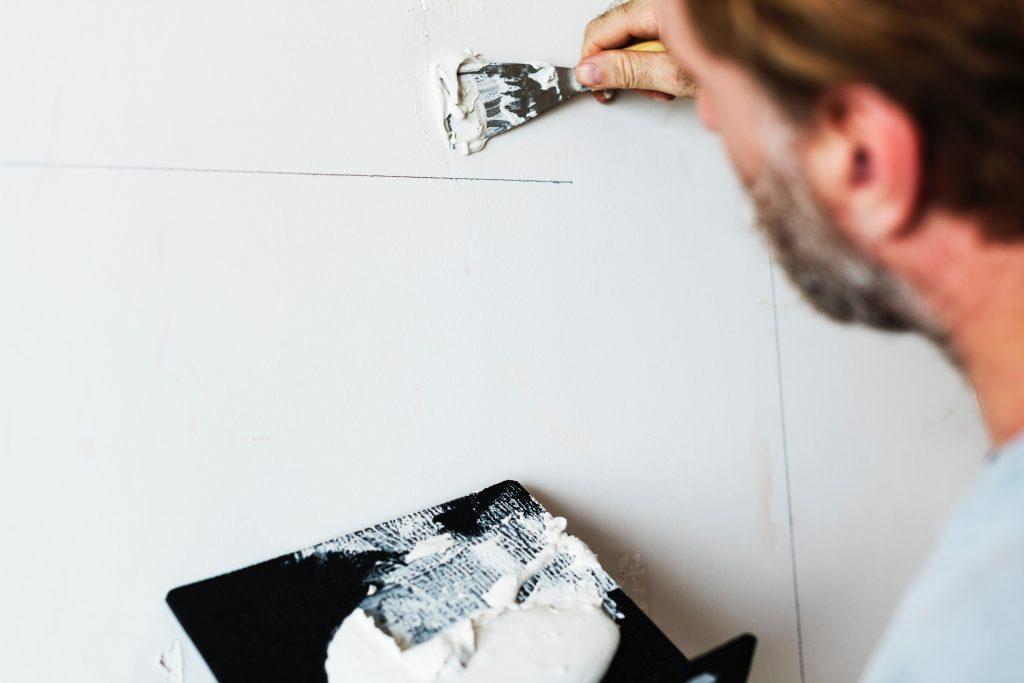 Man Repairing Drywall