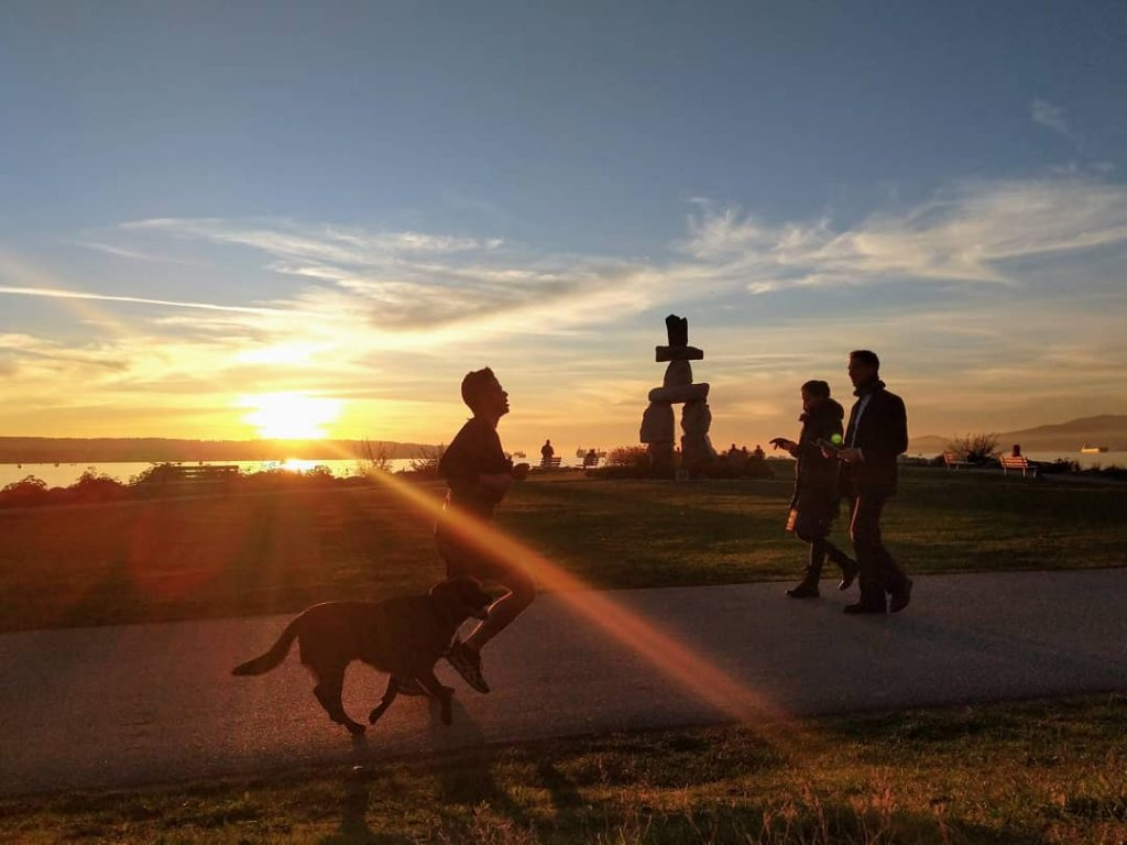 Vancouver Inukshuk Sculpture in English Bay at Sunset
