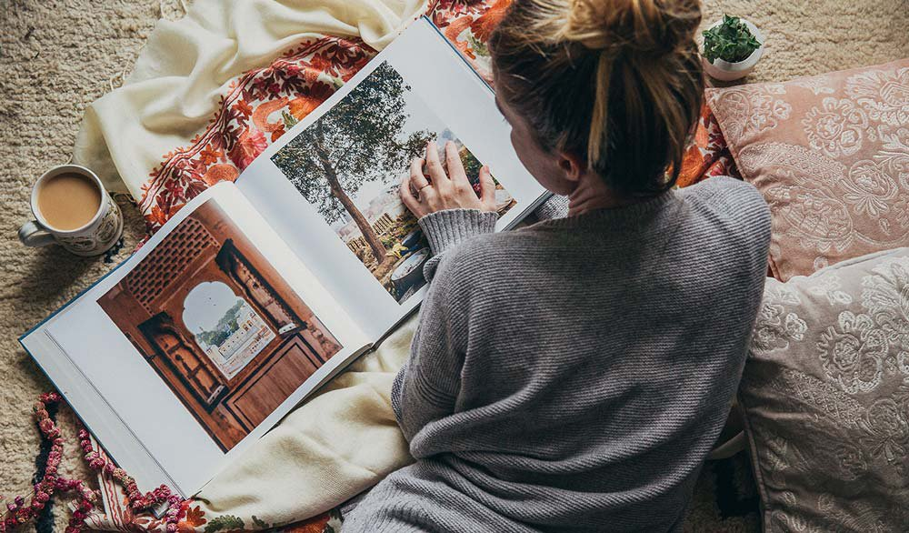 Woman Reading Book in Bed with Coffee