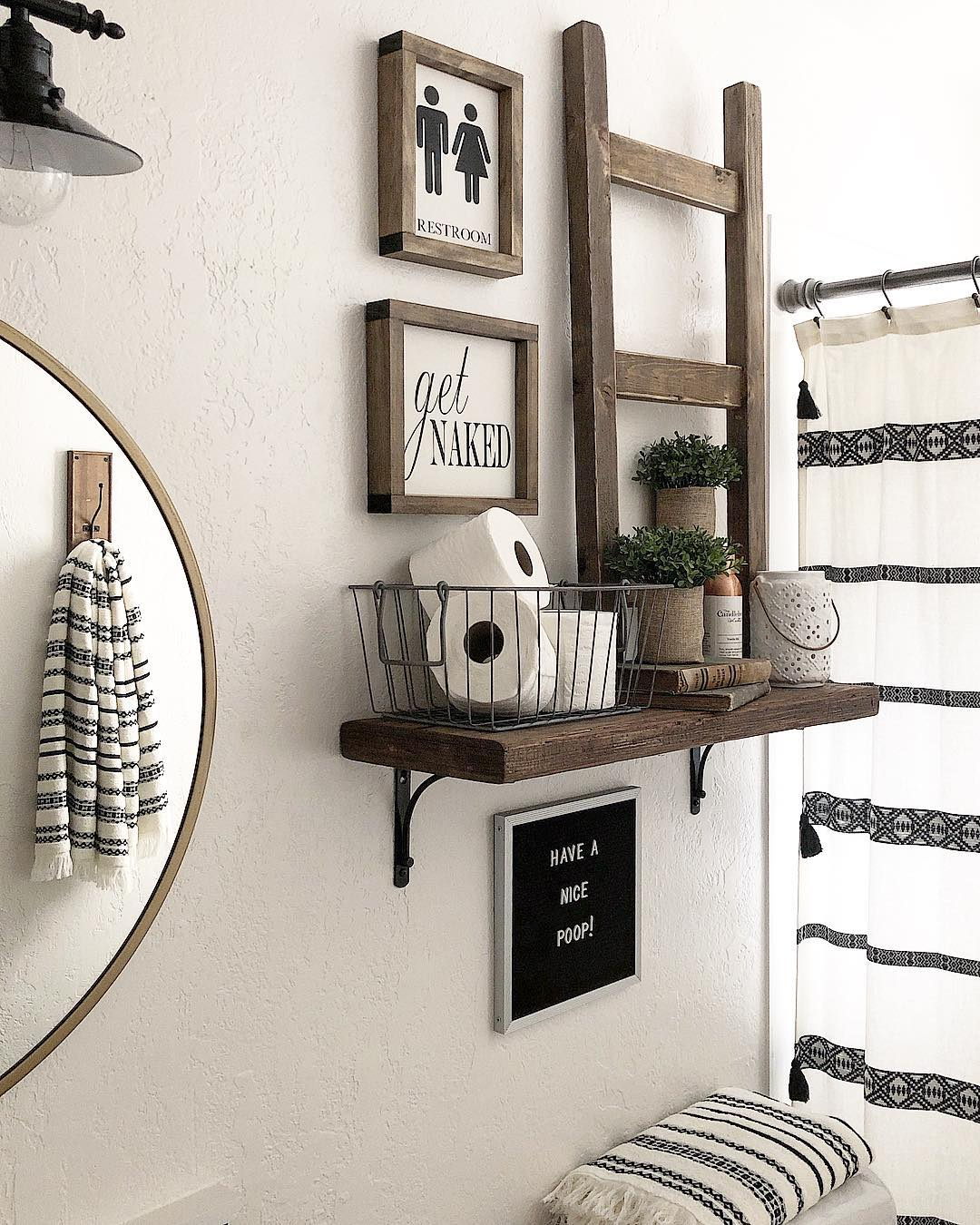 Bathroom Design with Reclaimed Wood Shelf and Picture Frames