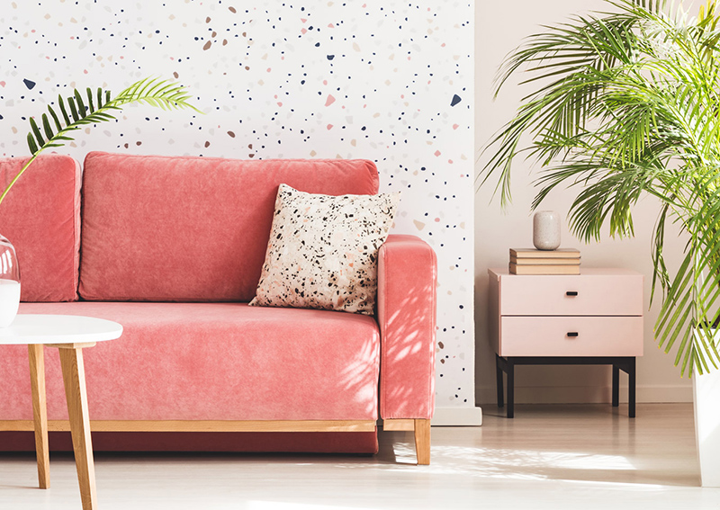 Coral couch in brightly lit apartment