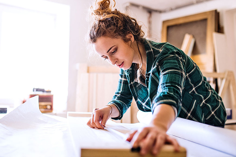 Young woman renovating her rental property